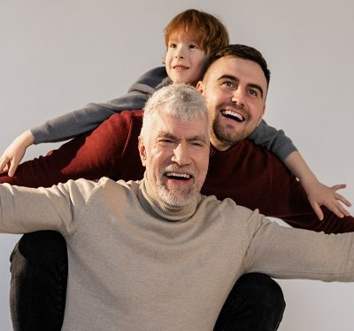 an elderly father with his son and grandson