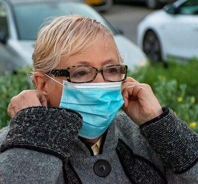 an elderly woman wearing a face mask