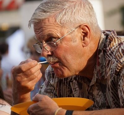 an elderly person eating